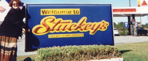 jpg of Elizabeth in front of the Stuckey's  sign